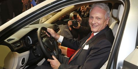 Motor vehicle, Automotive design, Steering part, Vehicle, Steering wheel, Automotive mirror, Car, Suit, Vehicle door, Luxury vehicle,