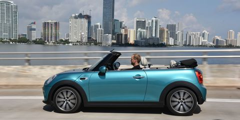 """<p>If there's one thing the Mini Cooper has, it's charm. Even people who normally don't care about cars love them. And you can get a convertible version for as little a $25,950. If you want more power, you can always <a href=""""http://www.roadandtrack.com/new-cars/first-drives/reviews/a14618/2010-mini-cooper-s-convertible/"""" target=""""_blank"""">bump up to the Cooper S</a> or <a href=""""http://www.roadandtrack.com/new-cars/news/a27910/2016-mini-john-cooper-works-convertible/"""" target=""""_blank"""">the top-level John Cooper Works version</a>. Even if you're generous with the option, you'll still end up safely under $45,000.</p>"""