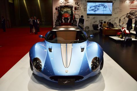 Mode of transport, Automotive design, Vehicle, Land vehicle, Car, Sports car, Supercar, Headlamp, Picture frame, Auto show,