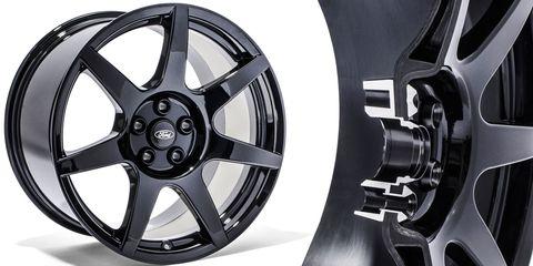 Alloy wheel, Automotive wheel system, Spoke, Rim, Automotive design, Auto part, Machine, Hubcap, Black-and-white, Synthetic rubber,