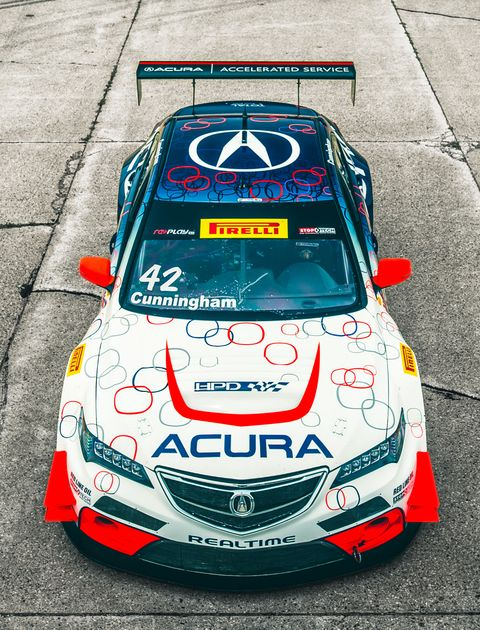 <p>The number of parts this TLX-GT shares with its streetgoing kin can be counted on one hand—a few badges, the engine block and heads, the unibody passenger cell, and not much else. Pop the hood and all you see is a tangle of silver pipes and radiators diving back toward the firewall. That's where the turbo V-6 lives, tucked so far back, it's hidden beneath the windshield.</p>