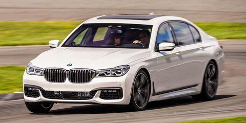 Land vehicle, Vehicle, Car, Luxury vehicle, Personal luxury car, Alloy wheel, Automotive design, Bmw, Rim, Wheel,