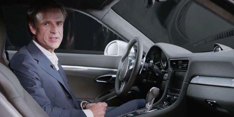 Motor vehicle, Automotive design, Mode of transport, Vehicle, Steering part, Steering wheel, Automotive mirror, Vehicle door, Car, Coat,