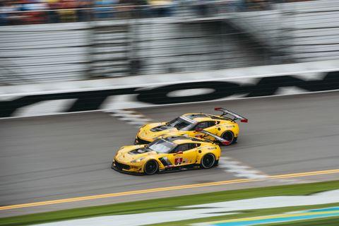 Automotive design, Race track, Sports car racing, Yellow, Motorsport, Sport venue, Performance car, Racing, Auto racing, Race car,