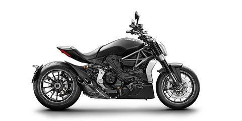 Motorcycle, Motor vehicle, Wheel, Fuel tank, Automotive design, Automotive tire, Transport, Spoke, Automotive lighting, Rim,
