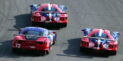 Vehicle, Sports car racing, Motorsport, Car, Performance car, Race track, Red, Race car, Touring car racing, Racing,