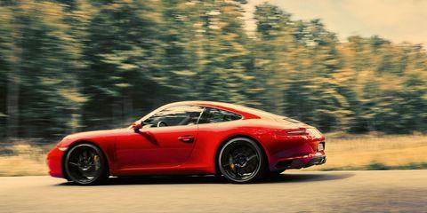 Tire, Wheel, Automotive design, Alloy wheel, Vehicle, Rim, Land vehicle, Performance car, Car, Red,