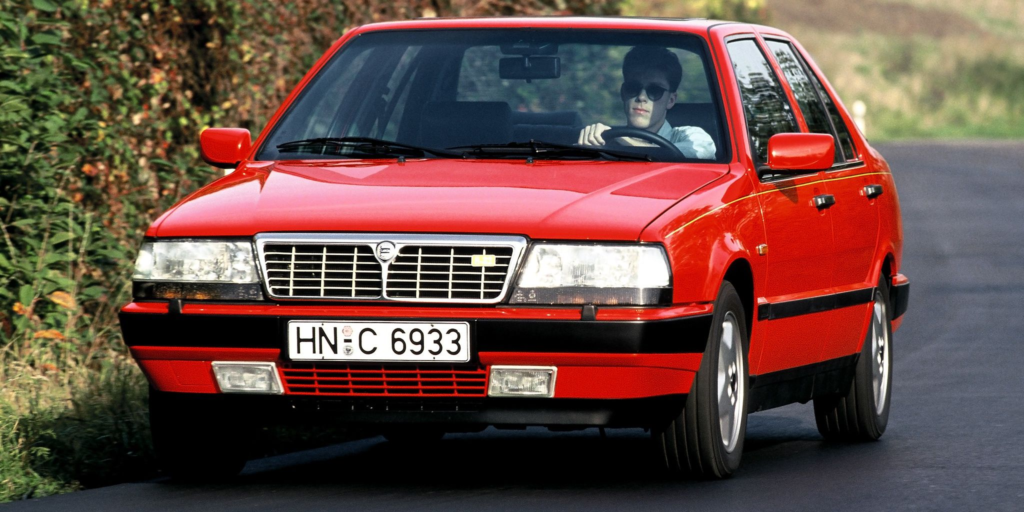 "thirty years ago, lancia stuffed a ferrari v8 and created the ""thema"