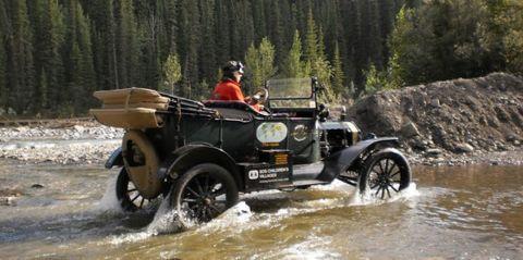 Tire, Wheel, Water, Fender, Helmet, Geological phenomenon, Classic car, Classic, Headlamp, Bumper,