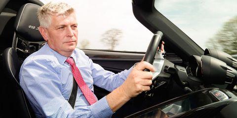 Motor vehicle, Automotive design, Vehicle, Car, Luxury vehicle, Driving, Businessperson, Windshield, Vehicle door, Auto part,
