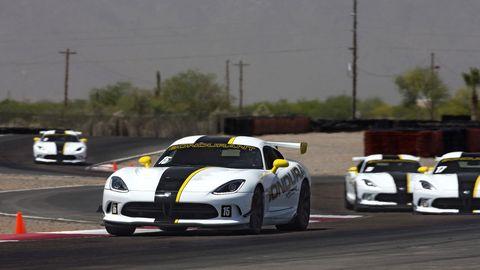 Automotive design, Vehicle, Land vehicle, Headlamp, Sports car racing, Car, Hood, Race track, Automotive lighting, Performance car,