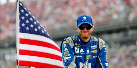 Eyewear, Cap, Vision care, Sunglasses, Flag, Flag of the united states, Jersey, Baseball cap, Facial hair, Electric blue,
