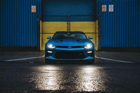<p>Here's the Camaro. Hyper Blue (great color), low-gloss black wheels (meh), 455 horsepower (yes), and, of course, a 6-speed stick.  </p>