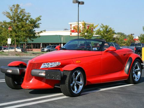 """<p>To inject a little excitement into the long-suffering Plymouth brand, Chrysler developed a rather radical retro hot rod for 1997. The Prowler was one of the first retro cars of this era, and <a href=""""http://www.popularmechanics.com/cars/news/vintage-speed/15-cars-that-couldnt-save-their-brand_?click=main_sr#slide-13"""">the last new Plymouth before the brand died</a>. In that first year only a handful were built. Every one of them was purple, equipped with a pokey 215-hp 3.5-liter V-6 from Chrysler's front-drive family sedans. After skipping a production year, the 1999 Prowler arrived with more colors and a 38-hp boost in oomph. </p><p>It just wasn't enough. Here was a great-looking, concept-car-come-to-life hot rod that had no V-8 engine beneath its fenders and no manual transmission either. What good is a hot rod that can't light up the tires into a white haze of burned rubber? The Prowler was still somewhat fun to drive just because of its radical looks, but the suspension was so rough you wouldn't be having fun for long—especially after your morning coffee resting in the cup holder had spilled on your pants after a mild pothole. And trunk space was so limited that Chrysler actually offered a $5000 trailer option to haul your gear. Weird.</p>"""