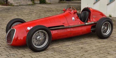 Tire, Automotive tire, Automotive design, Vehicle, Open-wheel car, Rim, Red, Automotive wheel system, Car, Fender,