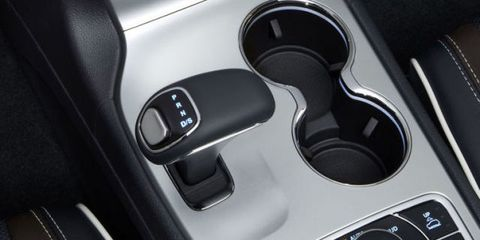 Automotive design, Luxury vehicle, Carbon, Personal luxury car, Silver, Gear shift, Gloss, Supercar,