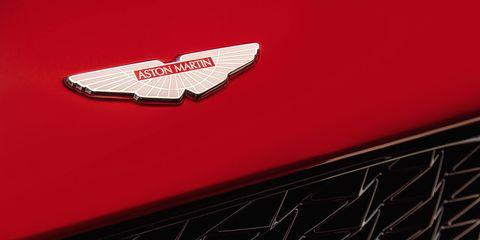 Red, Logo, Symbol, Carmine, Maroon, Emblem, Trademark, Classic car, Wing, Hood,