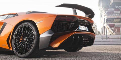 Tire, Automotive design, Mode of transport, Automotive exterior, Vehicle, Automotive lighting, Automotive tire, Rim, Automotive wheel system, Orange,