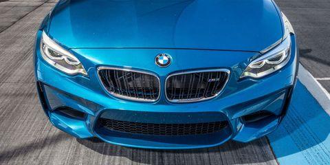 Blue, Automotive design, Vehicle, Grille, Automotive exterior, Hood, Car, Personal luxury car, Electric blue, Aqua,
