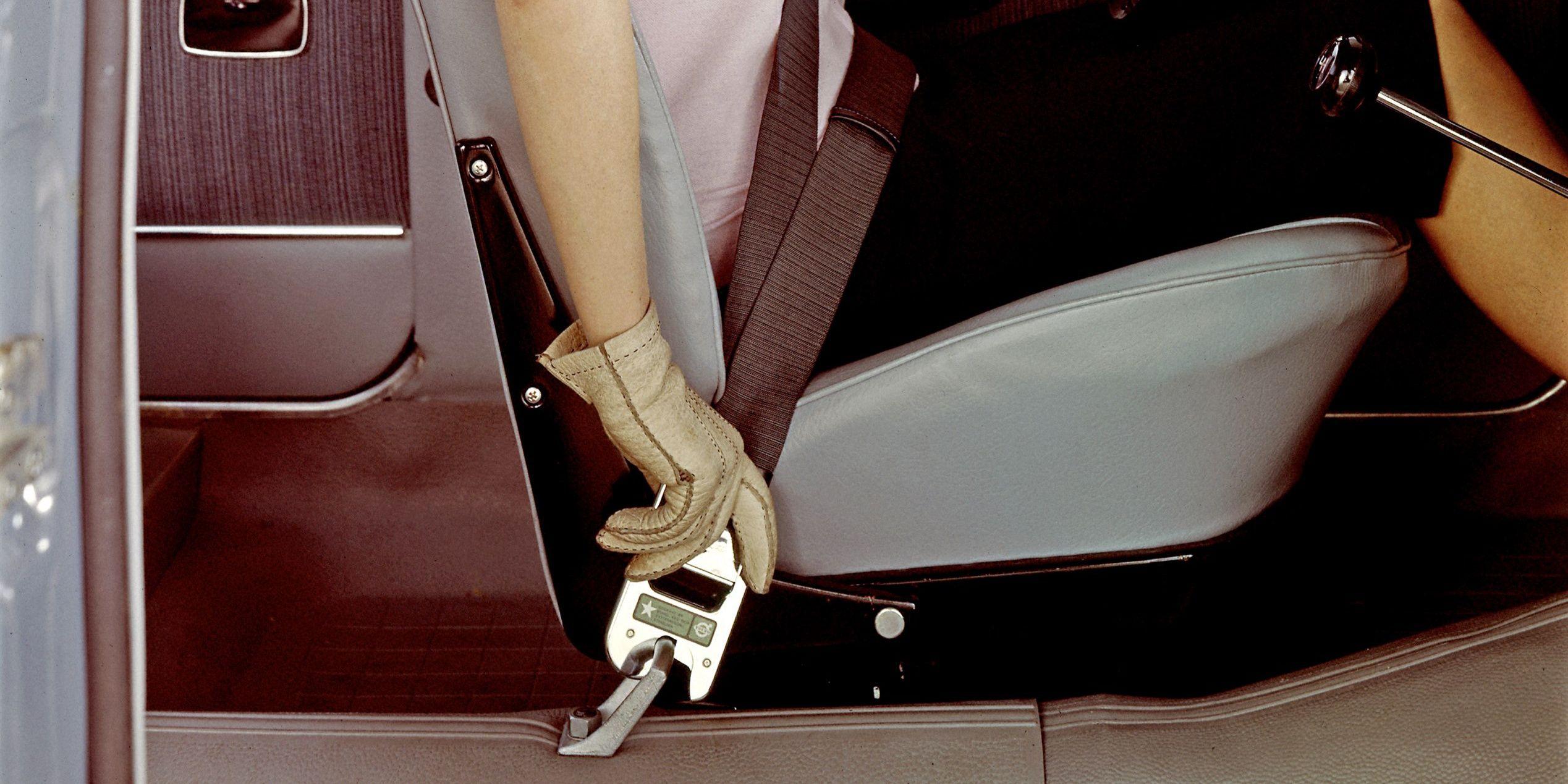 Unfastening the front seatbelt