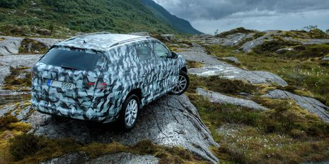 Car, Automotive exterior, Highland, Rim, Auto part, Vehicle door, Terrain, Mountain range, Bedrock, Sport utility vehicle,