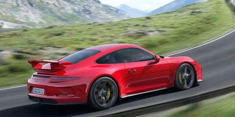 Tire, Wheel, Automotive design, Vehicle, Mountainous landforms, Alloy wheel, Performance car, Car, Red, Rim,