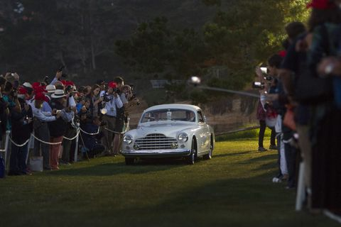 "This 1950 Ferrari 195 INTER Ghia Coupe from Desselgem Belgium opens the parade of classics, pre-dawn, Sunday morning onto the 18th green at The Lodge at Pebble Beach. This annual ritual that has come to be known as ""Dawn Patrol. Every year, the world's auto enthusiasts travel to the Monterey Peninsula to participate in the Car Week that culminates with the luxurious Concours d'Elegance classic car competition.   PHOTOGRAPHED SUNDAY AUGUST 16, 2015 (Photo by Don Kelsen/Los Angeles Times via Getty Images)"