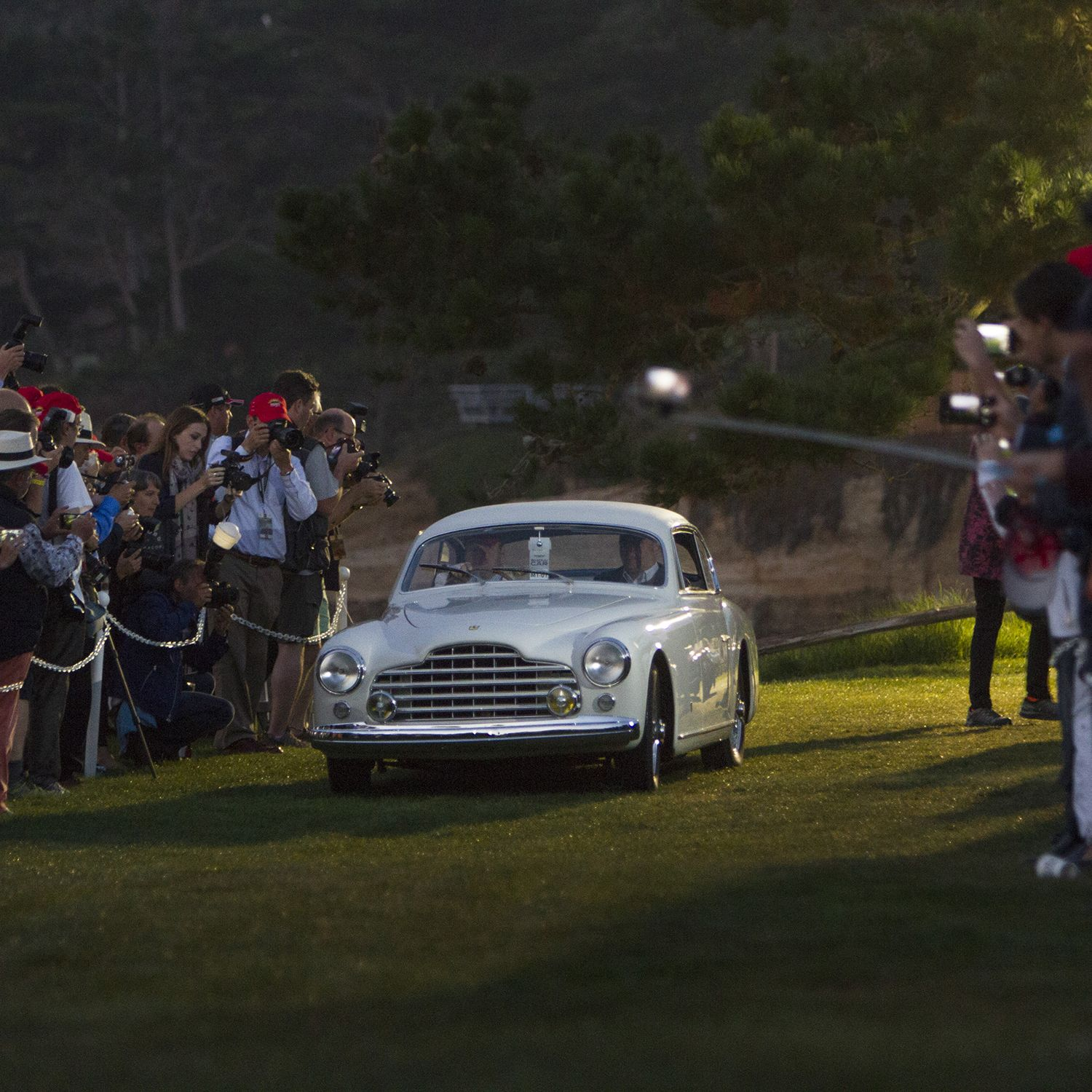 """This 1950 Ferrari 195 INTER Ghia Coupe from Desselgem Belgium opens the parade of classics, pre-dawn, Sunday morning onto the 18th green at The Lodge at Pebble Beach. This annual ritual that has come to be known as """"Dawn Patrol. Every year, the world's auto enthusiasts travel to the Monterey Peninsula to participate in the Car Week that culminates with the luxurious Concours d'Elegance classic car competition. PHOTOGRAPHED SUNDAY AUGUST 16, 2015(Photo by Don Kelsen/Los Angeles Times via Getty Images)"""