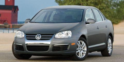 Motor vehicle, Automotive design, Daytime, Vehicle, Automotive mirror, Land vehicle, Transport, Car, Rim, Alloy wheel,