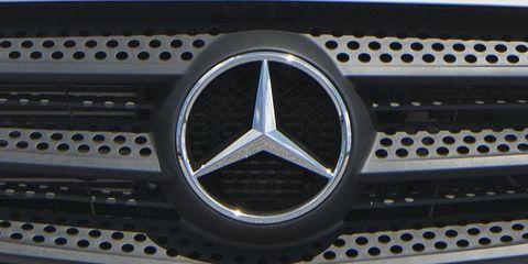Motor vehicle, Automotive design, Automotive exterior, Grille, Logo, Light, Symbol, Hood, Auto part, Emblem,
