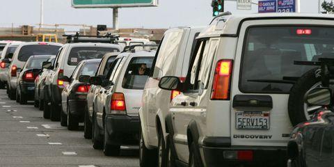 Motor vehicle, Automotive tail & brake light, Mode of transport, Vehicle, Land vehicle, Automotive parking light, Automotive exterior, Automotive tire, Transport, Car,