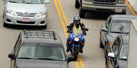 Motor vehicle, Mode of transport, Automotive design, Vehicle, Land vehicle, Motorcycle helmet, Automotive exterior, Motorcycle, Car, Helmet,