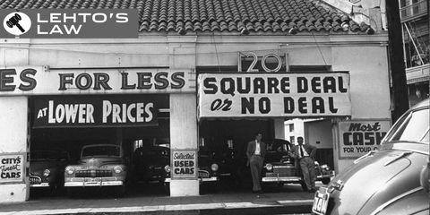 Motor vehicle, Automotive parking light, Automotive lighting, Classic car, Automotive exterior, Advertising, Classic, Signage, Monochrome, Antique car,