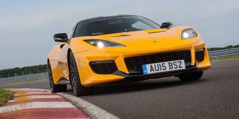 Mode of transport, Automotive design, Vehicle, Yellow, Transport, Hood, Car, Supercar, Road surface, Asphalt,