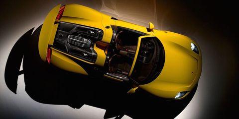 Motor vehicle, Automotive design, Yellow, Automotive exterior, Automotive lighting, Amber, Bumper, Headlamp, Automotive light bulb, Vehicle door,