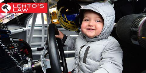 Child, Steering wheel, Baby & toddler clothing, Headgear, Toddler, Steering part, Laugh, Exercise machine, Baby, Machine,