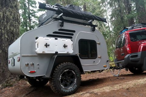 """<p>The&nbsp;<a href=""""http://www.oregontrailer.net/terradrop.html"""" target=""""_blank"""">TerraDrop</a>&nbsp;from Oregon Trail'R, is a custom built teardrop style&nbsp;off-road trailer. It&nbsp;sleeps two,&nbsp;with cabinets and storage for whatever personal belongings you see fit to bring along. A refractive interior&nbsp;lighting system keeps the inside warm&nbsp;while the&nbsp;outside includes a full-camping kitchen and attachments for a roof rack, gear, and other supplies. All of this backcountry&nbsp;luxury will cost you roughly $23,000.<span class=""""redactor-invisible-space"""" data-verified=""""redactor"""" data-redactor-tag=""""span"""" data-redactor-class=""""redactor-invisible-space""""></span></p>"""