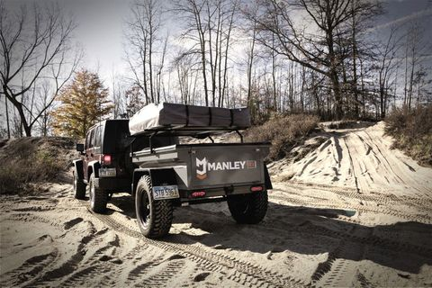 """<p>The&nbsp;<a href=""""http://manleyorv.com/trailers/morv-explore.html"""" target=""""_blank"""">Manley ORV Explore trailer</a>&nbsp;is sharpest looking trailer on this list. It's equipped with&nbsp;31-inch all-terrain&nbsp;tires, an aluminum lid, trailer rack, and roof top tent, all for $9,395.<span class=""""redactor-invisible-space"""" data-verified=""""redactor"""" data-redactor-tag=""""span"""" data-redactor-class=""""redactor-invisible-space""""></span></p>"""