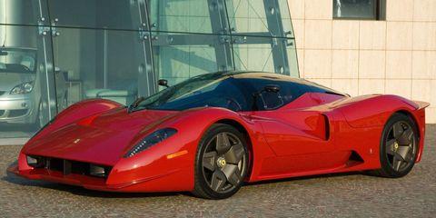 Tire, Mode of transport, Automotive design, Vehicle, Transport, Land vehicle, Automotive lighting, Red, Car, Performance car,