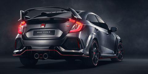 Automotive design, Vehicle, Automotive tail & brake light, Car, Automotive lighting, Red, Automotive exterior, Fender, Bumper, Trunk,