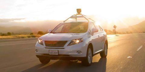 Motor vehicle, Tire, Mode of transport, Daytime, Automotive mirror, Vehicle, Road, Automotive lighting, Transport, Automotive exterior,