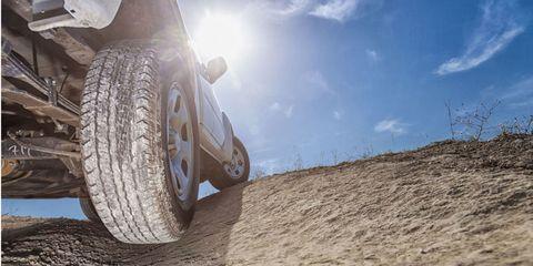 Tire, Automotive tire, Automotive design, Rim, Automotive wheel system, Landscape, Automotive exterior, Synthetic rubber, Tread, Auto part,