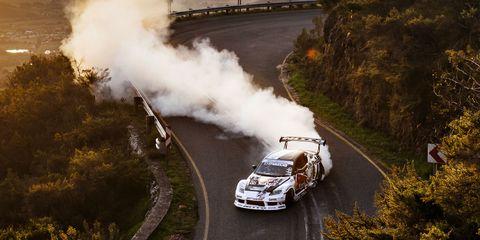 Automotive design, Transport, Car, Headlamp, Automotive lighting, Grille, Smoke, Bumper, Hood, Race car,