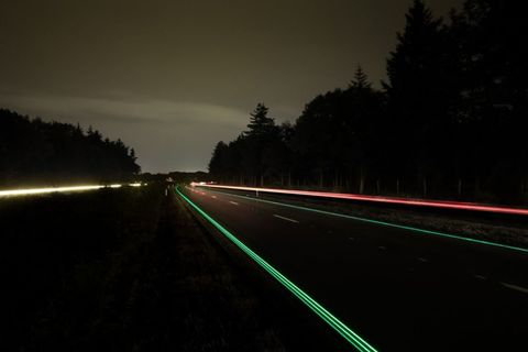 "<p>Glowing lines may supplant our ubiquitous overhead lighting, according to designer Daan Roosegaarde&nbsp;who's experimenting&nbsp;on a&nbsp;stretch of Dutch highway. He&nbsp;believes painting a rural road in glow-in-the-dark paint (which recharges in daytime and glows for eight hours) would be easier to install than a system of light poles, more&nbsp;environmentally friendly, and far safer, allowing drivers to easily see the edges of the road and the pavement markings. And on the N329 highway, some 60 miles south of Amsterdam, the glowing road lights up in long, green streaks. Though not without its initial teething problems, it did look pretty great: ""sometimes it's about just making really cool, poetic, <i data-redactor-tag=""i"">Matrix</i>-like landscapes,"" says Roosegaarde.</p><p><span class=""redactor-invisible-space"" data-verified=""redactor"" data-redactor-tag=""span"" data-redactor-class=""redactor-invisible-space""></span></p>"