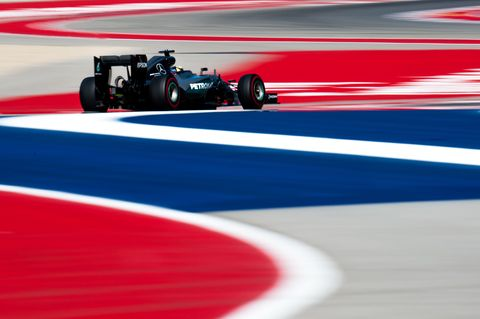 Tire, Automotive tire, Automotive design, Open-wheel car, Sport venue, Formula one tyres, Red, Formula one, Formula one car, Race track,