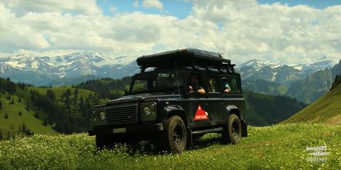 Tire, Wheel, Vegetation, Mountainous landforms, Sky, Automotive design, Natural environment, Automotive tire, Vehicle, Land vehicle,