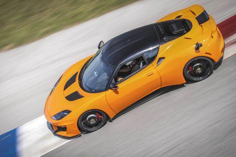 Tire, Automotive design, Yellow, Vehicle, Automotive mirror, Hood, Performance car, Car, Automotive parking light, Automotive tire,