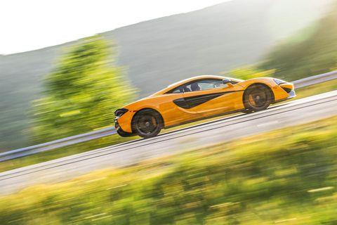 Tire, Wheel, Road, Mode of transport, Automotive design, Vehicle, Yellow, Land vehicle, Rim, Automotive lighting,