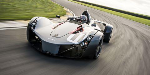 Mode of transport, Automotive design, Automotive tire, Automotive wheel system, Car, Plain, Fender, Rim, Automotive exterior, Asphalt,