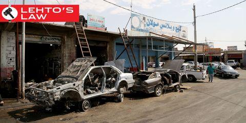 Motor vehicle, Vehicle, Land vehicle, Car, Automotive parking light, Signage, Crash, Street light, Personal luxury car, Scrap,